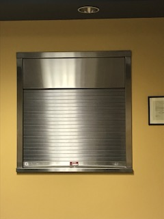 Rolling Counter Fire Shutter with Integral Frame and Sill